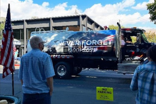 Parade goers standing silence in tribute to the twenty year anniversary of the 9/11 terrorist attack.