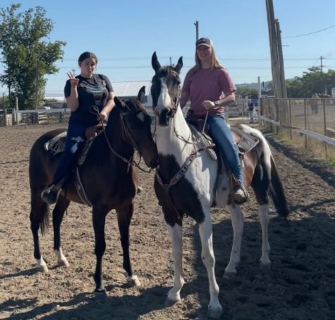 Ace and his rider Mya Peterson (pictured left) and his brother  Thunder and his rider Alyssa Smith (pictured right) pose for a picture